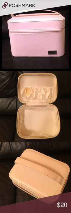 Cute white caboodle case in faux leather! Artistry- White caboodle case for makeup or whatever u want! Zip around closure with handle on top. Has multiple slip pockets inside. Inside lining has stain (pic2). But outside is stainless. Original duster bag included! Offers welcome! Artistry Bags Cosmetic Bags & Cases