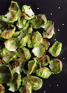 Roasted Brussels Sprouts Chips - Looking for a seasonal, high-fiber, and low-calorie salty snack? It's time to whip up a batch of crispy veggie chips made from roasted brussels sprouts. (I would use coconut oil instead of olive oil.