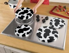 Set of 4 Cow Burner Covers hides and protects burners when not in use—and brings cheer to your kitchen. Cow Kitchen Decor, Kitchen Items, Kitchen Dining, Cow Ornaments, Burner Covers, Kitchen Storage Solutions, Cooking Appliances, Cow Print, Cows