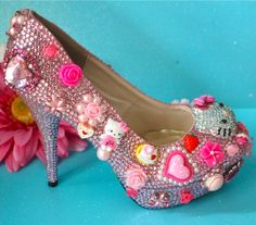 Hello Kitty shoes.....wow these are so cute i want them, but then I would be so judged for wearing them :)