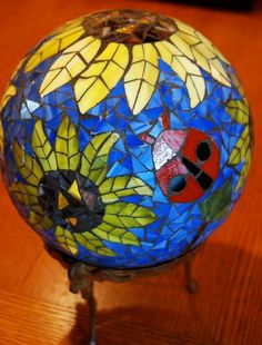 Gazing Ball Lady Bug and Bee in the Sunflowers Stained Glass Mosaic Garden Sculp Mosaic Garden Art, Mosaic Art, Mosaic Glass, Mosaic Tiles, Stained Glass, Glass Art, Bowling Ball Crafts, Mosaic Bowling Ball, Bowling Ball Art