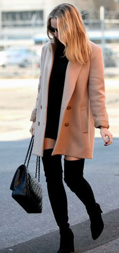 Wear the camel coat trend with over the knee boots and a black polo mini dress to recreate Helena Glazer's sophisticated look. Whip out a pair of shades to get that additional glamour. Via Just The Design. Coat: Theory, Dress: Susana Monaco, Boots: Stuart Weitzman 'All Legs', Sunglasses: Dior.