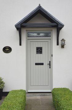 Staverton entrance door finished in French Grey. Kathedral glass toplight with Queen Anne lead. Antique Black ironmongery and Bevel Amber leaded glass design. Manufactured in Engineered European Redwood. Cottage Style Doors, Cottage Front Doors, Cottage Door, Cottage Exterior, House Doors, Country Front Door, Timber Front Door, Grey Front Doors, Double Front Doors