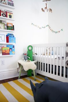 white walls, yellow/white striped rug, with navy accents for boys room.