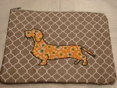 Mini tote or cosmetic bag with wire dachshund applique by StitchedByShawn on Etsy
