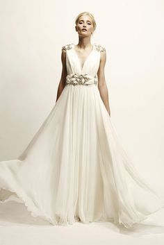 Used Marchesa embelished empire waist dress Resort 2010 Size 8 for $2500. You saved 44% Off Retail! Find the perfect preowned dress at OnceWed.com.