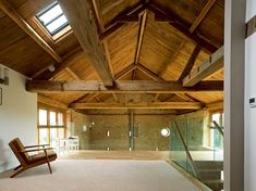 exposed roof trusses and wooden barn roof
