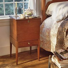 Add Character with Antiques: An antique sugar chest is just the right height to serve as a bedside table. Repurposing pieces like this gives your bedroom character and interest.