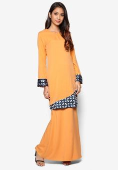Baju Kurung Modern from Gene Martino in Brown Look absolutely chic with this Baju Kurung Modern by Gene Martino. Crafted from smooth and sleek material, this piece is adorned with stones near the hemline and features songket-design on the hemline and sleeve ends. Definitely a piece that will... #bajukurung #bajukurungmoden