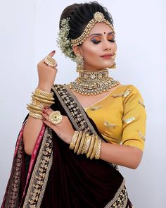 In a bridal look in a black color saree, elbow length sleeves blouse design, necklace, hip chain and gold jewelry Saree Wedding, Wedding Dresses, Bridal Makeover, Indian Bridal Makeup, Bridal Blouse Designs, Bride Makeup, Saree Styles, Indian Designer Wear, Bride Hairstyles