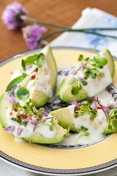 Avocado Appetizer with Chive Flowers   32 Edible Flowers - The Complete List Of Flowers You Can Eat & Flower Recipe Ideas