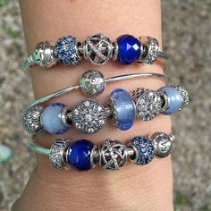 Radiant Bloom beads are dazzling works if beauty. Blue and silver will have a…