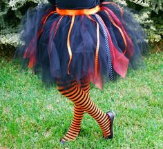 Wacky Witch Halloween Costume // You will need: ribbon and tulle in colors or patterns of your choice. A very full skirt will require approximately 5 yards of tulle. You may adjust the amount of tulle needed for your height and width. First, measure enough ribbon to fully wrap around your waist and tie in order to secure your wacky witch skirt. Secondly, cut your tulle into long strips. Lastly, tie the cut strips onto the ribbon. Add a black shirt and striped socks as a final touch!