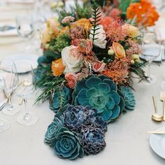 Three more pretty shots from our Santa Fe wedding @martha_weddings @lisavorce @brycecoveyphoto - centerpieces of ruffled succulents, tulips, protea, rice flower, grevillea and ranunculus.