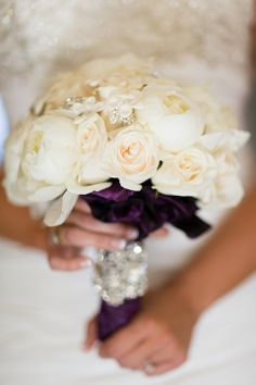 The colors of my wedding was eggplant but I wanted a white bouquet so the flowers  were white and the bottom was deep purple.