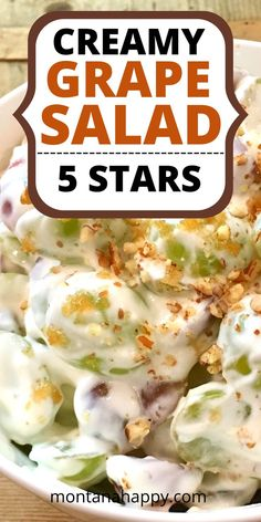"""This old-fashioned Creamy Grape Salad recipe will have your tastebuds dancing in no time! Red and green grapes are covered with cream cheese, sour cream, sugar, vanilla, and topped with brown sugar and pecans. Can you say """"YUM?"""" This delicious side dish or dessert is the perfect recipe to take to any gathering. 