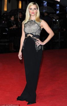 Reese Witherspoon looked stunning in a black floor-length gown with sheer pannelling and snakeskin bodice at the London Film Festival premiere of Wild http://dailym.ai/1sCrtIr