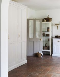 A terracotta floor, a Classic English sink cabinet and a large full height pantry cupboard which includes storage and refrigeration in the… Stone Flooring, Kitchen Flooring, Floors Of Stone, Kitchen Walls, Kitchen Tile, Flooring Ideas, Estilo Colonial, Quarry Tiles, Devol Kitchens