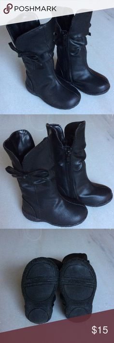 Toddler black tall boots size 4 fits 9-12 mos New never worn black tall boots with zip side & bow detail. Baby/toddler size 4 fits 9-12 mos. No box or tags but boots are in perfect condition!...material is man made leatherette. Shoes Boots