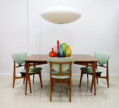 Midcentury modern dining, mint and wood. And yet they somehow feel oddly out of place in this setting.