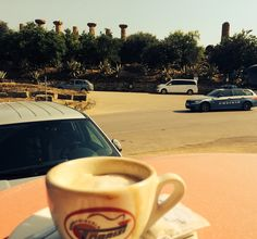 What better way to end a visit in sweltering heat to the Valley of the Temples, Agrigento, Sicily than a cappuccino overlooking one. This is one of the oldest from 6bc, temple of Hercules, with just a few pillars standing....not a half bad coffee either.