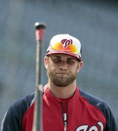 Washington Nationals left fielder Bryce Harper tosses his bat during ...