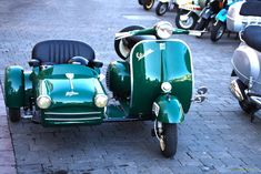 Looks like an early 1950s Vespa 125 with an adorable Faysan sidecar.