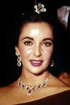Elizabeth Taylor wearing the Mike Todd ruby and diamond Cartier suite which he gave her in August 1957.