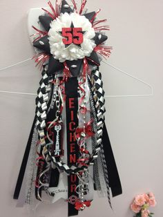 Just when I'm almost finished, I get word that Freshman can't have white mum flowers in their homecoming mums. They must be red or black. Balls.