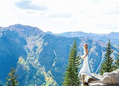 Our fearless bride Jodi got married on Aspen Mountain- elevation 11,212 feet!! Stunning photo! // The Katie May Poipu gown