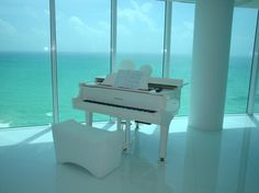 It would be awesome to play a white piano with a scenary like this