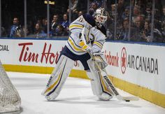TORONTO, ON - MARCH 26: Chad Johnson #31 of the Buffalo Sabres handles the puck against the Toronto Maple Leafs during the first period at the Air Canada Centre on March 26, 2018 in Toronto, Ontario, Canada. (Photo by Mark Blinch/NHLI via Getty Images)