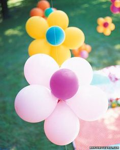 "Titled ""Flower Power Baby Shower How-to"" but this balloon arrangement would also be perfect for a girl's party!"