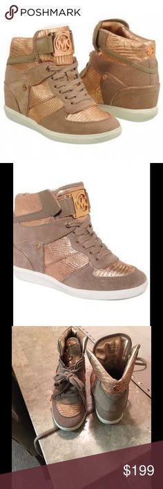 """Michael Kors Nikko Wedge Trainers SZ 7.5 The eye catching Nikko wedge trainers are the latest addition to the Michael Kors collection. Crafted from beige suede & metallic textured. Step out in confidence in the Nikko wedge hi-tops. Metallic textured leather. Rose gold hardware. Lace fasten. Signature logo details. 3"""" concealed wedge  These run small. 7.5 feels like a 7 Worn once for less than an hour I then realized I need a size larger. I need an 8 these are a 7.5. Like new. Michael Kors…"""