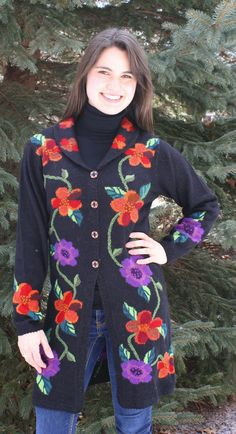 Brooklyn Alpaca Sweater  Brooklyn - Mid length alpaca sweater great with leggings and jeggings hand intarsia floral cardigan with hand painted buttons, hand crocheted edges, hand embroidery details.   www.purelyalpaca.com