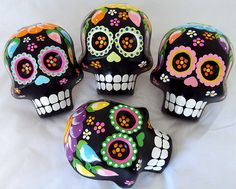 By using a sugar skull mold and filling it with plaster and inserting a pin, you can make quick and easy sugar skull jewelry. Sculpey clay can also be used. Sugar Scull, Sugar Skull Art, Day Of The Dead Party, Day Of The Dead Skull, Sculpey Clay, Mexican Skulls, Mexican Folk Art, Sugar Skull Design, Colorful Skulls