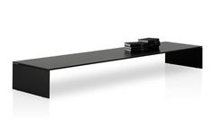 Modern Light bench by Piero Lissoni: once again He brings together form and function in this bench designed for italian firm Porro. Lightness is defining quality of the piece, only 12 mm thick in varnished iron and completed with an MDF top. Lacquered finishing is available in a variety of matt colors.