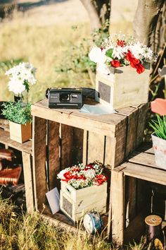 wooden crates as tables to display florals and decor #weddingdecor #weddingdetails #weddingchicks http://www.weddingchicks.com/2014/01/22/rockabilly-wedding-ideas/