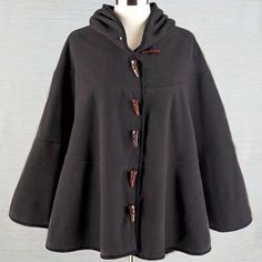 HP10/27/15 Great poncho  Gorgeous hooded poncho in the color charcoal.Toggle buttons and extremely stylish and lightweight.✨✨✨✨New in package Jackets & Coats Capes