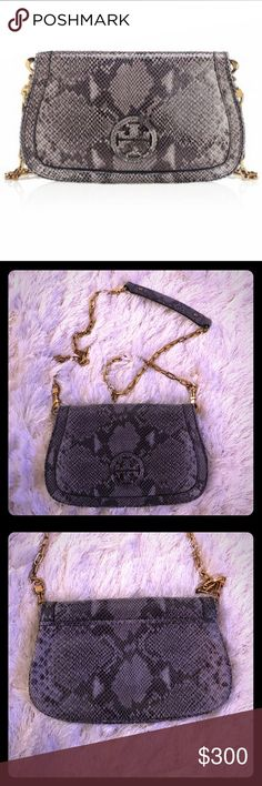 Tory Burch Amanda Clutch Authentic Tory Burch Amanda Clutch in grey snake print. Rare, beautiful, and in excellent condition. Rarely used, inside hardware still has original protective covering! Can be worn as a clutch or crossbody. Comes with original dust bag. Tory Burch Bags Clutches & Wristlets