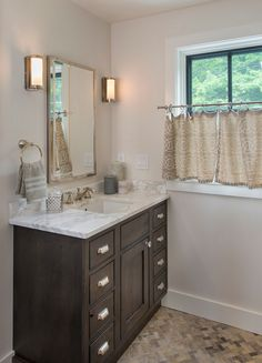 Bathroom paint color is Benjamin Moore Sea Pearl. Cabinet Stain: Starmark Slate Gray stain with ebony glaze on Rustic Alder wood. Countertop: Calacutta Gold marble. Cabinet Knob: Emtek. Cabinet Pull: House of Antique Hardware. Faucet: Delta Cassidy.