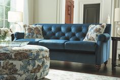 La-Z-Boy's deep blue velvet and nailhead trim add fashion-forward edge to elegant tufted sofas. You can also choose one of La-Z-Boy's new stain-resistant iClean™ fabrics — no need to keep kids and pets away! Shown, Aberdeen sofa in Nile (C140787). Plus, PIN TO WIN an ottoman! Get contest details at http://houseandhome.com/la-z-boy | #LaZBoy #Furniture #Sofa #LivingRoom