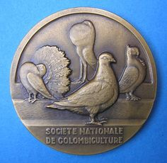 Georges Contaux – Bronze Medal   Art Deco  Pigeons – Bronze Medaille    A finely minted art deco style bronze medal designed by the French artist Georges Contaux c1950. This medal feature 4 fancy pigeons and was awarded c1962 by the Societe Nationale De Colombiculture.
