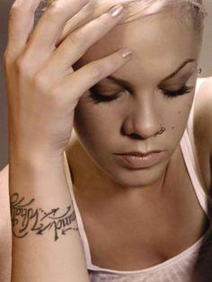 """Pink's """"What goes around comes around"""" wrist tattoo."""