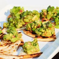 Chef Rusty's Kivado Crostad, grilled flatbread chunky guacemole and kiwi with balsamic glaze