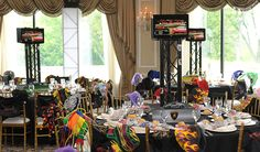Bar Mitzvah & Bat Mitzvah Decor & Design: Custom car themed centerpiece with TVs by MMEink Event Design & Productions. mmeink.com. Call us to learn how we can help you with your next event: 877.885.0705