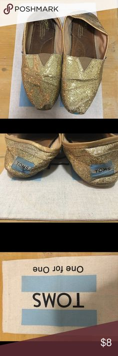 Tom's Gold Glitter Shoes - 7 These preloved Tom's have a ton of life left in them. These are super comfortable and the gold glitter surely pops. Size 7. Tom's Shoes Flats & Loafers