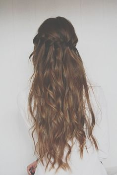 Love this curly hair with the waterfall braid. Classic.