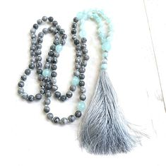 Jasper & Amazonite Mala Beads - Mala For the Heart & Throat Chakra - 108 Beads - Hand Knotted - 8mm Length 40 - 6mm Length 31 A strong securing Mala designed with Gray Picasso Jasper,Amazonite and Agate from True Nature Jewelry. Custom handmade it features Picasso Jasper known to