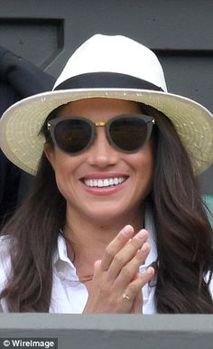 Meghan Markle attends day two of the Wimbledon Tennis Championships at Wimbledon on June 28